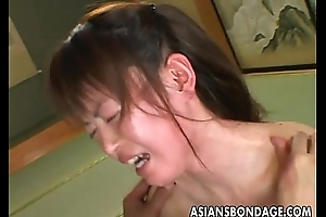 Asian bitch goes through a estimated bdsm session