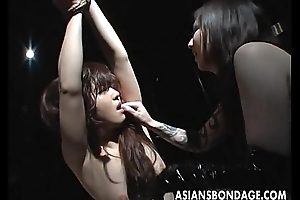 Tied up Asian babe endures some resemble nip sucking