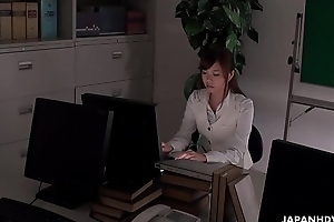 Office worker getting some juice up as her work gets boring