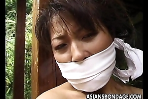 Tied up matured Asian cougar to a house beam